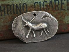 Hey, I found this really awesome Etsy listing at https://www.etsy.com/il-en/listing/233442401/primitive-design-animal-pendant-hand