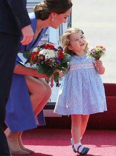 Catherine Duchess of Cambridge with Princess Charlotte on arrival in Germany. July 19 2017