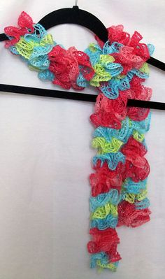 Girls blue, lime green, lt.pink and dk pink scarf hand knitted with a mini frill yarn that makes kid-size ruffles for your favorite girl.