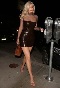 Kylie Jenner stuns in a fitted latex dress and high heels