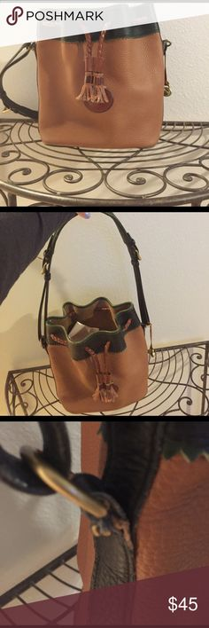 Dooney and Bourke bucket bag Vintage D&B bucket bag. Has wear on both sides where the strap and bag meet. It is in Used condition. Great bag, I just bought others and will not be using this one. Ask questions if you have them. Thanks. Dooney & Bourke Bags Shoulder Bags