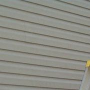 how to repair a hole in vinyl siding