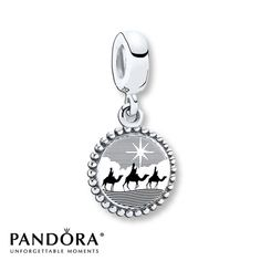 Following the Star of Bethlehem, the Three Kings are depicted as they travel in this sterling silver dangle charm from the Pandora Holiday 2014 collection. Style # USB791169-G060.