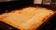 The best Meat and Cheese Lasagna - INGREDIENTS  Olive oil 9 lasagna noodles 1 lb lean ground beef 1 28 oz tomato sauce 4 oz Parmesan cheese Ricotta cheese 1 large onion 2 tomatoes 2 eggs 3 garlic cloves half red and green pepper diced in small cubes 1 stalk celery 1 tbsp tomato paste 24 oz Mozzarella cheese 1 tsp fresh oregano Salt and pepper to taste