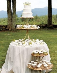 Vintage two-tiered metal tables, sprinkled with wildflowers, are perfect cake stands.