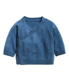 Fine-knit cardigan in soft cashmere. Wrapover front section with buttons, long raglan sleeves, and ribbing at cuffs and hem.