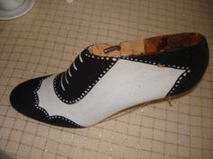 Black and white old wooden shoe form.