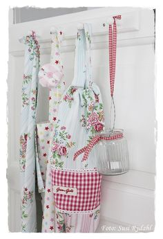 Cath Kidston plastic bags keeper hanging from a peg rail