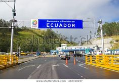 IPIALES, COLOMBIA - JULY 4, 2016: some cars driving trough the migration checkpoint in the border line between colombia and ecuador