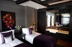 Hotel Canal House in Amsterdam is comprised of 17th century merchants' houses. The interior design is modern but warm, with rich chocolate browns and gorgeous purples. The colours are a great match for the floral still lifes that are displayed in the rooms.