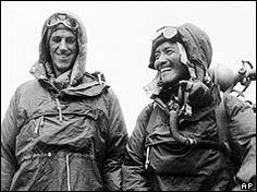 Edmund Hillary and Sherpa Tenzing Norgay conquer Mt. Everest. May 29, 1953.  The two men hugged each other with relief and joy but only stayed on the summit for 15 minutes because they were low on oxygen. Mr Hillary took several photographs of the scenery, while Sherpa Tenzing buried some sweets and biscuits in the snow as a Buddhist offering to the gods.