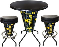 Michigan Wolverines D1 Black Lighted Pub Table Set. Two additional Stools are optional. Visit SportsFansPlus.com for details.