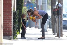 Cute: The two-some stop for a chat, it looks like Noah is more interested in his mom's pho...