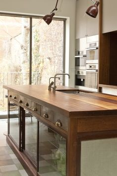 Kitchen island built from existing carcass possibly...using an antique unit to form the basis of a central island unit...like the look and feel of the handles/lights