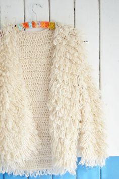 This is a PDF file with the wood & wooly cardigan sleeves pattern. pages) The pattern is written in ENGLISH. The pattern is in American Loop Stitch Crochet, Mode Crochet, Crochet Coat, Crochet Jacket, Crochet Clothes, Cardigan Au Crochet, Cardigan Pattern, Knitting Patterns, Crochet Patterns