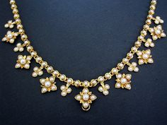 Gorgeous antique Victorian gold and half-pearl necklace from about 1960. Found on Vicmart.com.