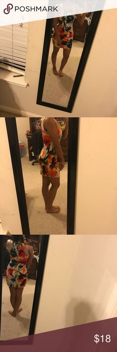 Colorful Fitted Dress Beautiful body con type dress. Lovely to pair with heels or open toed shoes. Can be worn professionally and casually. Dresses