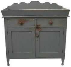 """V417 Berks Co. Pennsylvania, Drysink, with dry old gray paint, scalloped back splash, dovetailed canted well, dovetailed drawers, very gracefully turned feet. circa 1820 all original measurements are: 38 1/2"""" wide x 19"""" deep x 39"""" tall Primitive Cabinets, Primitive Furniture, Primitive Antiques, Country Furniture, Home Decor Furniture, Painted Furniture, Primitive Country, Primitive Decor, Antique Furniture"""