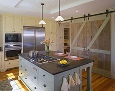 barn doors in the kitchen can close off or really open up a large area