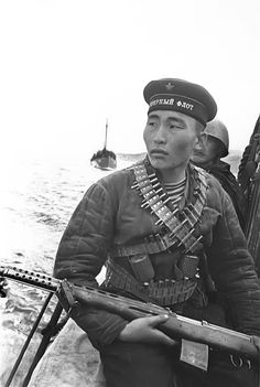 Soviet Marine sniper Rad Ayusheyev of the 63th Marine Division, 1942. He's packing a Tokarev SVT-40 semiauto rifle