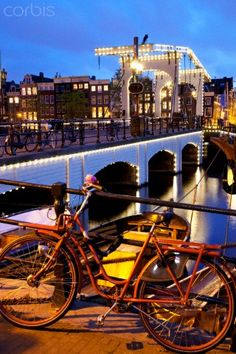 Magere Brug (Skinny Bridge) at dusk, Amsterdam, Holland, Europe