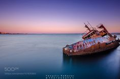Poseidons Revenge by kakavas_v  sky sea sunset water boat blue ocean waves ship seascape abandoned long exposure bay rust vessel wre
