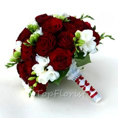 Wedding bouquet of red roses and freesias
