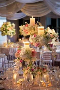 tall wedding reception centerpiece idea via brian dorsey studios / http://www.deerpearlflowers.com/unique-wedding-centerpiece-ideas/3/