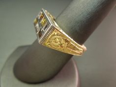 """Men's Art Deco """"EGYPTIAN"""" Gold & Platinum 0.60 carat Multicolored Diamond Ring Constructed of 18KT Yellow Gold Complimented with Egyptian Style Hand Engraving Front & Back of ring depict a Winged Sun Disk Sides of ring depict a Sarcophagus Containing 7 Baguette cut Natural colored Diamonds weighing a total of 0.60 carats Diamonds set in a Rectangular Platinum plate Ring weighing 12 grams  Item Number:  WS1865"""