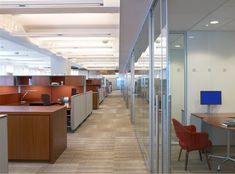 Open work space lined with meeting rooms