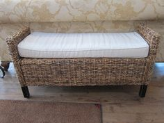 Rattan bench with a cushion.