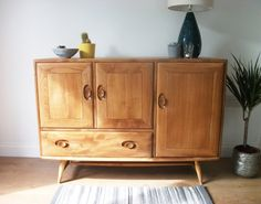 Ercol Sideboard with Splayed Legs - Retro by RetroCactusFurniture on Etsy https://www.etsy.com/uk/listing/476045635/ercol-sideboard-with-splayed-legs-retro