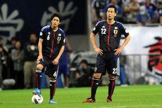20120608 SAITAMA, JAPAN - JUNE 08:  Atsuto Uchida (L) and Maya Yoshida (R) of Japan look on during the FIFA World Cup Brazil Asian Qualifier match between Japan and Jordan at Saitama Stadium on June 8, 2012 in Saitama, Japan.