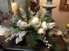 Celebrate the most exciting and cherished holiday of the entire year with Gorgeous Christmas Floral Arrangements that bring nature indoors and set a mood of generosity and appreciation. Christmas Flower Arrangements, Christmas Flowers, Christmas Table Decorations, Silver Christmas, Floral Arrangements, Christmas Wreaths, Christmas Crafts, Holiday Decor, Family Holiday