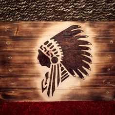 Rustic burnt wooden board with chief silhouette design. Pyrography home decor