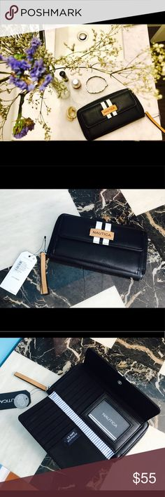 NAUTICA  Women's Wallet Shop the Nautica Banyan Signature Zip around Wallet Brand new with tags   Color Black  Lined with blue and white striped fabric   Compact with tons of convenient compartments   With RFID Blocking protection, to keep your identity, credit cards, passports safe from thieves that can simply scan your wallet. Nautica Bags Wallets