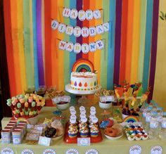 rainbow birthday party decore | Stunning party table with all kinds of treat and fun decorations!
