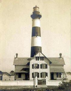 This is an old picture of the light.  Erosion has washed away the surrounding land.  You can drive to the far east end of the island park and walk in through an old coast guard station to view the lighthouse from the end of the island.    Morris Island Lighthouse, South Carolina at Lighthousefriends.com