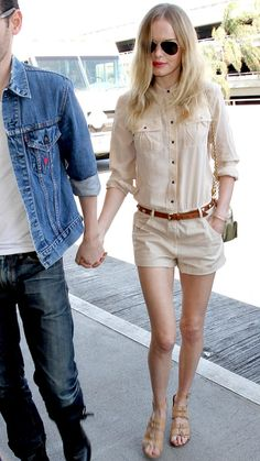 Kate Bosworth - street style.  Bosworth went for a monochromatic look—an ivory button-down (buttoned all the way up!) with matching shorts—that she broke up with a studded leather belt, a metallic purse and buckled sandals.