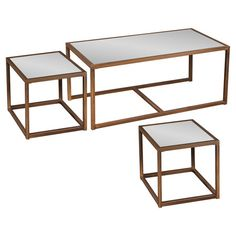 Set of 3 nesting tables with bronze-finished cube bases and mirrored tops.   Product: 1 Cocktail table and 2 end tablesCo...