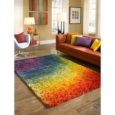 Jazz up and brighten your room with a colorful twist with this eye-popping Canteburry Rainbow Shag Rug. This multicolored contemporary Egyptian shag rug is made from polyester and polypropylene and measures in 5'2' x 7'7' with a 1.6' pile.