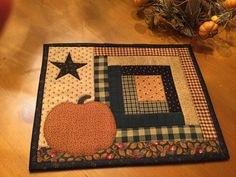 This little quilt is made with the log cabin block and it has a appliqued pumpkin & star on it. I quilted it in the ditch and blanket stitched around the appliques. Small but sweet . This is sure to add some charm where every you put it.  The inside batting is warm and natural. The binding is hand sewn The fabric used is 100% cotton.  Measurements: 9 x 12 inches.  Hand crafted in my smoke free & pet free studio and is ready to ship.