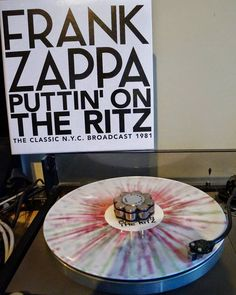 "#Nowspinning : #FrankZappa  #Puttin'OnTheRitz #LetThemEatVinyl  LETV182LP 4  #Vinyl #LP #Album #DeluxeEdition #LimitedEdition #UnofficialRelease #White w/#RainbowSplatter #Europe 2014 #Rock #Avantgarde ""The Classic N.Y.C. Broadcast 1981"" Release Date November 17 2014 Live At The Ritz New York City November 17th 1981. The Classic N.Y.C. Broadcast 1981.  Players  Frank Zappa (lead guitar vocals) Al Di Meola (guitar on Clowns On Velvet and Ride Like The Wind) Ed Mann (percussion) Tommy Mars…"