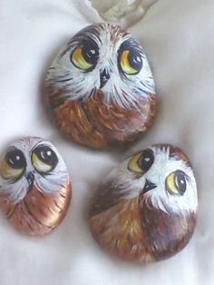 Brown owls painted on stone