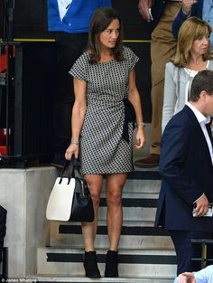 Colour coordinating: Pippa wore a monochrome graphic print dress with matching handbag. Invictus games. 9/2014.