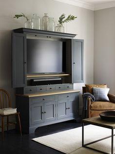 Henley 5ft AV dresser. Caspar tan leather armchair. Carter coffee table #AVcabinet #Dresser #CleverStorage #AW16