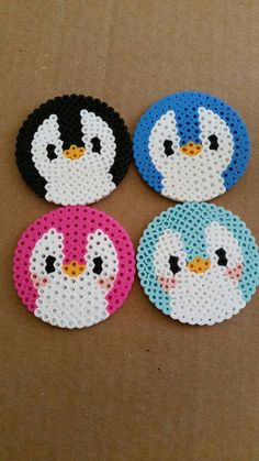Penguin face perler bead coasters with cork backing. Set of 4. Pink, black, baby blue and blue.