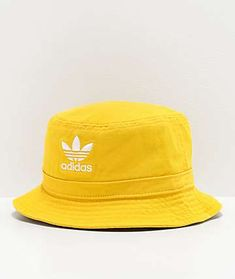 Add a classic to your headwear collection with the adidas Originals yellow and white bucket hat. This classic bucket hat comes in a unique bright yellow colorway, with an embroidered trefoil adidas logo at the front, this hat is a must-have whether it is Bucket Hat Outfit, High Fashion Outfits, Outfits With Hats, Steampunk Fashion, Victorian Fashion, Gothic Fashion, Fashion Fashion, Vintage Fashion, Adidas Bucket Hat