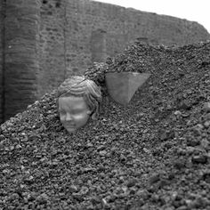 Statue of boy emerging from volcanic lapilli in the House of Successus. Pompeii, 1952.