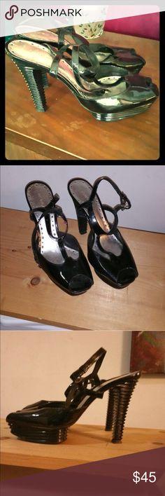 BCBG Girls black peep toe strappy heels BCBGirls black peep toe strappy heels. Unique stair teird heels.  Shiny black.  Adjustable straps size 9. Sexy BCBGirls Shoes Heels